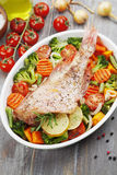 Roasted fish with vegetables Royalty Free Stock Images