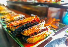 Roasted fishes with chillies stock photo