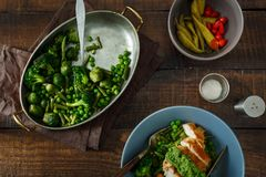 Roasted French bean, Brussels sprouts, green peas, chicken breas. Roasted French bean, Brussels sprouts, green peas and chicken breast on a dark wooden Stock Images