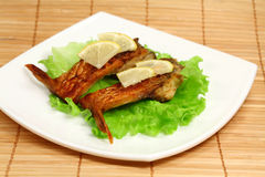 Roasted fresh bream on a plate Royalty Free Stock Image