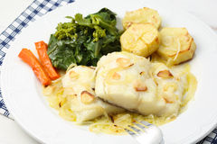 Roasted fresh cod fillet with cabbage and potatoes Royalty Free Stock Image