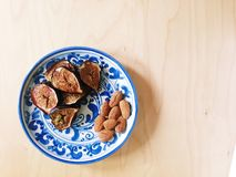 Roasted fresh figs and almonds on blue and white plate Royalty Free Stock Photo