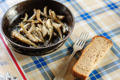 Roasted fresh river fish on cast iron pan Stock Photo