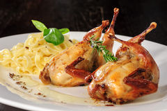 Roasted or fried quail with herbs and tagliatelle Stock Photography