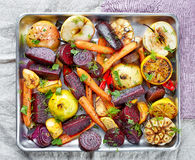 Roasted fruits and vegetables stock images