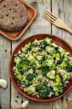 Roasted garlic broccoli quinoa salad Stock Images