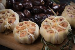 Roasted garlic bulbs. Used in soups, sauces and stews Royalty Free Stock Image