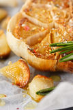 Roasted garlic close up. Royalty Free Stock Image