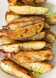 Roasted garlic potatoes vertical upclose Royalty Free Stock Photo