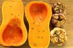 Roasted garlic and pumpkin. Stock Photos