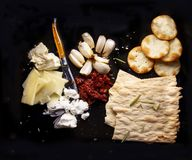 Cracker cheese plate on black background royalty free stock photo