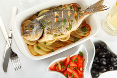 Roasted gilt-head bream with potato Royalty Free Stock Photos