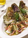 Roasted Globe Artichokes with Pancetta Egg Stock Photography