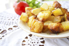 Roasted golden potatoes Stock Image