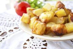 Roasted golden potatoes Stock Image
