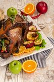 Roasted goose with apples and oranges wooden blue background. Festive dinner. delicious dish. top view stock photos