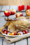 Roasted goose with apples and vegetables Stock Photo