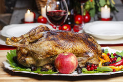 Roasted goose in autumn setting. Festive and party decoration Stock Photo
