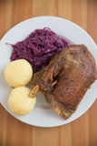 Roasted goose leg with braised red cabbage Stock Photo