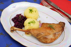Roasted goose leg with red cabbage and dumplings Stock Photos
