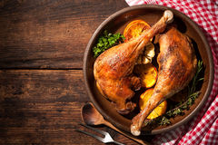 Roasted goose legs with oranges. And spices. Cooking at Christmas time stock photography