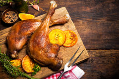 Roasted goose legs with oranges Stock Photos