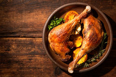 Roasted goose legs with oranges Stock Photography