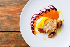 Roasted goose liver with date fruit and apple Stock Image