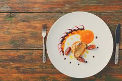 Roasted goose liver with date fruit and apple Stock Photo