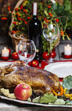 Roasted goose on the table Stock Photos