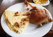 Roasted goose thigh with potato tortillas Stock Photos