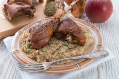 Roasted goose thighs with grits Stock Photo