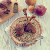 Roasted goose thighs with grits - retro vintage Royalty Free Stock Images