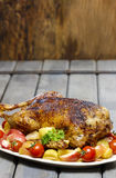 Roasted goose on wooden table Royalty Free Stock Image