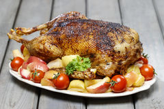 Roasted goose on wooden table. Festive and party dish Royalty Free Stock Photos