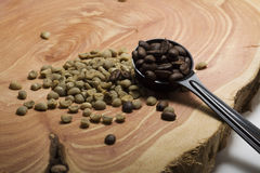 Roasted and green coffee beans on a juniper slab Stock Photo