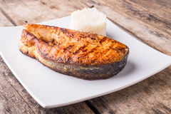 Roasted grill salmon steak with rice on plate Royalty Free Stock Photography