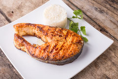 Roasted grill salmon steak with rice on plate Stock Photos
