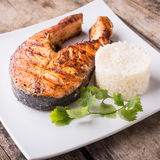 Roasted grill salmon steak with rice on plate Stock Images