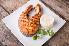 Roasted grill salmon steak with rice on plate Stock Image