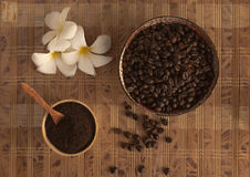 Roasted ground coffee. Two cups of coffee filled with flower stock image