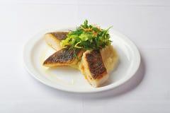 Roasted halibut. Bites of roasted halibut with mashed potato stock images