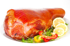 Roasted Ham for Christmas with chill and Lemon Royalty Free Stock Photo