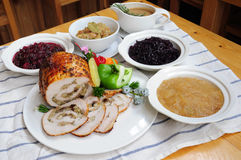 Roasted Ham. On a server tray and herbs on fall harvest table. Red wine, side dishes, pie, and gravy Stock Photos