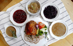 Roasted Ham. On a server tray and herbs on fall harvest table. Red wine, side dishes, pie, and gravy Royalty Free Stock Photos