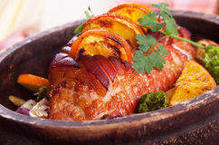 Roasted ham with vegetables. Roasted christmas ham with orange slices and vegetables Royalty Free Stock Photography