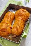 Roasted hasselback butternut squash pumpkin Stock Image