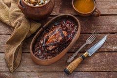 Roasted Hazel Grouse meat with buckweat porridge and cranberry sauce. Roasted Hazel Grouse buckweat porridge and sauce stock photo