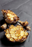 Roasted Head of Garlic over Slate Stock Photos