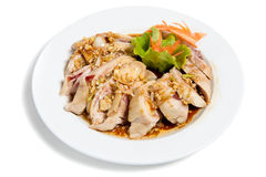Roasted hen in sauce on a plate Royalty Free Stock Images